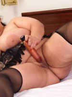 Sam has a lucking toy between her massive tits and fucks her shaved pussy