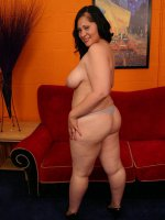 Hot photos of a sexy BBW named Teedra stripping off her clothes and acting sexy for the camera