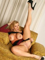 Sexy chubby blonde Sara Jay is wearing a short sexy skirt spreads pussy