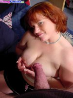 Plump red-haired babe tries on a pearl necklace