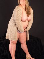 Fat slut in a sweater showing her huge natural tits