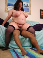 BBW gal Sassy gets naked in front of a black stud and gets him to give her mouthfuls of cock and cum
