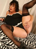 Short haired bbw hottie in stockings spreading her long legs and pussy