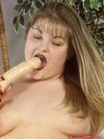 Blonde bbw with a toy cock sucking on it
