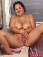 Smoking hot chubby latina sitting on a bathroom counter top
