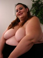 Naughty BBW model Ann taking off her clothes to expose her huge folds of fat before cramming her cooze live