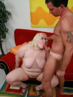 Huge blonde bbw Tina pleasures a big fat cock by cramming it down her deep throat