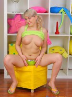 Chubby blonde schoolgirl nails herself with a big dildo