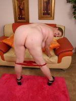 BBW Charlly shows off her wet snatch while playing with her heavyweight stack of knockers