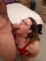 Large blonde chick enjoying a mouthful of meat stick