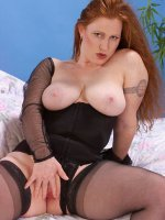 Chubby redhead hottie Sara in black stockings playing with her big tits