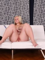 Full blonde teeny spreads her pink pussy lips