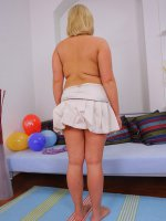 Chubby young doll gives her shaven slit a rubbing