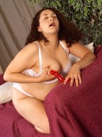 Big brunette milf Janelle playing her little red dildo pumping her hole