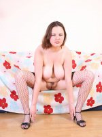 Cute young XXL girlie with classy bust gets naked
