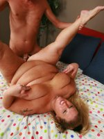 Blonde plumper Lilly west slowly stripping off her clothes to show off her huge fat butt