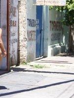 Plump Latina teen walks around naked in public