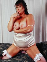 Chubby Terra in sexy white lingerie playing with her big tits and pussy