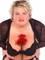 Stunning bbw milf having some fun with some roses on her hot naked body