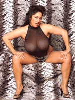 Smoking at latin bbw milf Ashley flaunting her huge tits and sexy legs