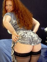 Stunning red head in black stockings and heels playing with her perfect pussy