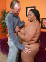 Ebony BBW Chocolat Hottie takes cock filling in her cooze and takes cum glazing all over her chocolate tits