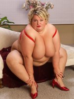 Hot Sinclair wearing red silky lingerie masturbating and shows her fat pussy
