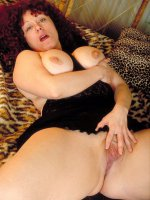 Big sexy brunette Yvette squeezing her big juggs and touching her wet clit