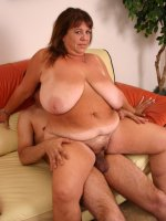 Hot BBW with huge tits Mercy bouncing on top while a hunk ram jobs her fatty cunt