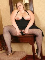 Super size hot blonde Christina showing her great fat curves in stockings