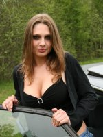 Slightly chubby babe with big tits strips outdoors