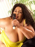 BBW Dios teases by sucking a dildo as she shows off her massive big tits