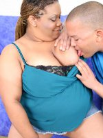 Plump ebony whore squeezing her huge tits while getting fucked