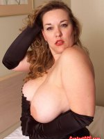 Chubby hottie Cathy in a pair of stockings and sexy lingerie