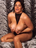 Fat woman Ashley posing and teasing as she plays with her huge boobs
