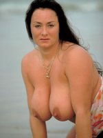 Big fat Betty Boob posing and spreadng by the sea and fondling tits