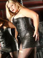 Blonde BBW Tiffany Blake in latex skirt posing and seducing in on red chair
