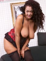 Smoking hot asian bbw hottie in lingerie and black stockings touching herself