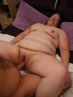 Naughty BBW Lorelie in bed and spreading her thick fat thighs to welcome a rock hard dong live