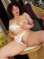 Beautiful BBW mom Yvette spreading her thick legs and touching boobs