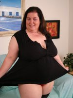 A lovely matured fatty named Sassy posing naked for the camera and jilling off her cooze
