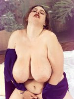 Chubby hottie Karise posing in violet showing big tits an hairy pussy