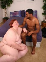 Brunette bbw Amnita worshipping a thick black cock by going down on her knees and sucking it