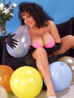 Fatty brunette Ashley posing and showing her big fat tits with balloons