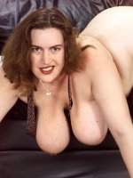 Fatty and stunning mature Karise with big tits poses in her office attire