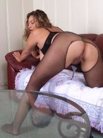 Chubby babe Loretta posing nude gets off her sexy black stockings