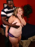 Sassy bbw Dani paired with a black hunk and gets black cock impaling in her fat covered gash