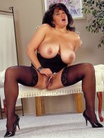 Beautiful mature bbw chick Ashley wearing black stockings licking boobs