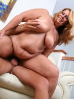 Tanned mature whore having her flabby belly rubbed with jizz