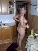 Amateur chubby teen posing in the kitchen